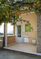 Mediterranean stone house with sink and toilet on terrace