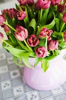 Bouquet of pink tulips in china vase