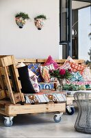 DIY sofa elementS with patterned seat cushions on wooden pallets