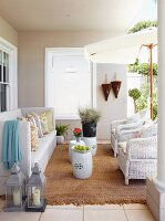 White sofa and rattan armchairs in loggia