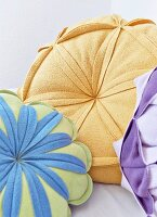 Flower-shaped scatter cushions in various colours