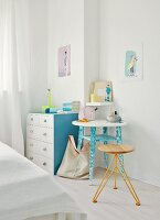 Heirloom chest of drawers and table refreshed with pastel paint combined with lamp and stool by young designer
