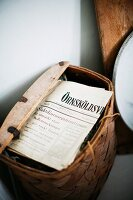 Rustic basket of Swedish newspapers