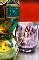 Candles in colourful Oriental tealight holders with ornate patterns