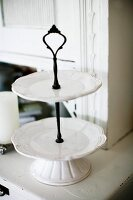 White china cake stand on dresser