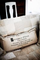 Scatter cushion with printed lettering on seat cushion