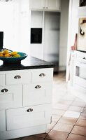 White kitchen base unit with drawers and stainless steel shell handles