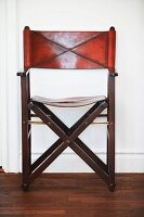 Classic, wooden folding chair with leather seat and backrest