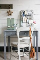 Shabby chic study area in grey with fabric pin board on painted wooden wall