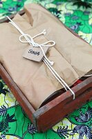 Wooden crate used as picnic hamper with name tag