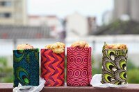 Cornbread for a picnic baked in tin cans & wrapped in colourful print fabrics