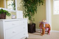 White cabinet with mirror and soft toy; Azusa; California; USA