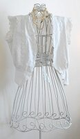 Nostalgic lace blouse on white, vintage-style, wire tailors' dummy