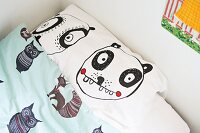 Children's bed linen with cartoon characters and animal motifs