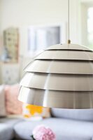 Pendant lamp with metal lampshade made from stainless steel hoops