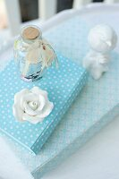 China rose and bird ornament on books with white and blue patterned covers