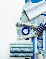 Rolls of wallpaper in different shades of blue
