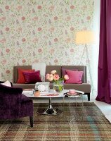 Floral wallpaper in living room with pale brown couch