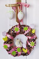 Easter door wreath made from willow branches decorated with satin ribbons, felt flowers & wooden flowers