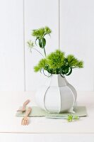 Green sweet William in white designer vase by Dik Scheepers