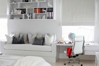Fitted couch and desk as space-saving solution in white, teenager's bedroom
