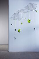 Unusual Advent calender - numbered baubles suspended from floating wire mesh shapes