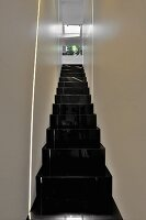 Narrow staircase with glossy black stairs