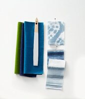 Blue and green fabric samples