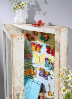 Crocheted butterflies in a display cabinet