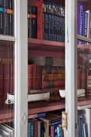 Antiquarian books in glass-fronted cabinet