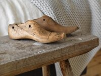 Vintage shoe lasts on rustic wooden bench