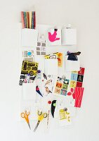 Mood board with postcards and office utensils