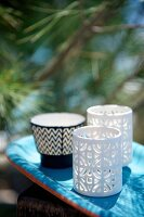 Bone china tealight holders with perforated patterns