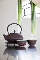 Cast-iron teapot and bowls on kitchen counter
