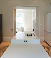 Private Apartment, London, United Kingdom. Architect: Hill Mitchell Berry, 2014. Combined dining table and kitchen counter