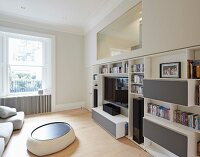 Private Apartment, London, United Kingdom. Architect: Hill Mitchell Berry, 2014. Modern pouffe used as coffee table in living room