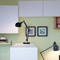 Two desk lamps with articulated stands for a home office and as a bedside lamp