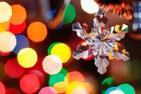 Retro, glass snowflake Christmas decoration with colourful spots of light