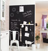 Retro metal chair against blackboard wall in rustic kitchen
