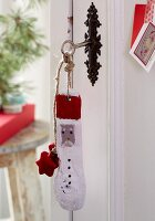 Homemade key rings made from painted driftwood with Christmas motifs