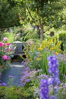 Wooden bench in flowering garden