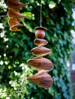 Wooden spiral mobile hanging in garden