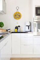 Detail of modern, white fitted kitchen