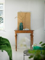 Ornamental grasses in retro vase on antique console table