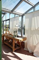 Rustic workbench and wooden toys in conservatory