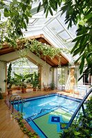 Indoor pool with colourful tiled bottom and glass roof