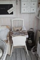 Vintage wooden board on white-painted wooden chair