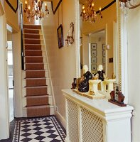 Hallway with chequered floor tiles and steel staircase in traditional, English country house