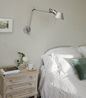 Tolomeo wall lamp and shabby-chic bedside cabinet next to double bed