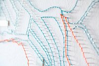 Stylised string-art map on white wall (detail)